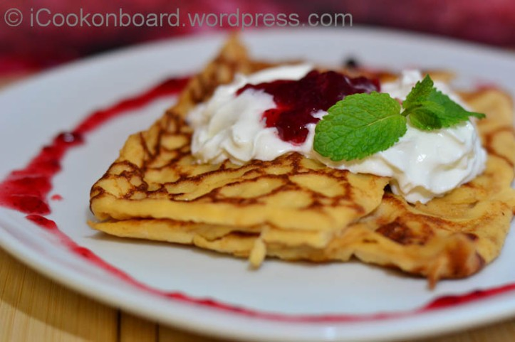 Swedish Pancake with cream, raspberry jam and mint. Photo by Nino Almendra