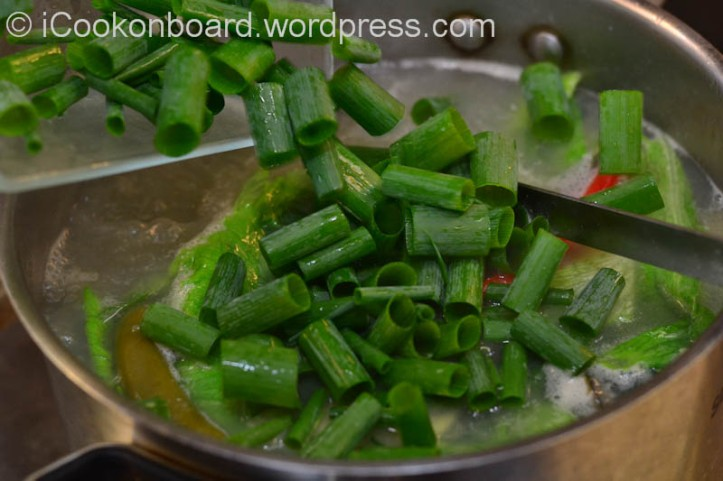 Garnish with Freshly chopped spring onions.