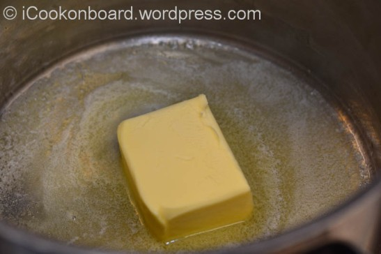 Melt butter on a soup pot.