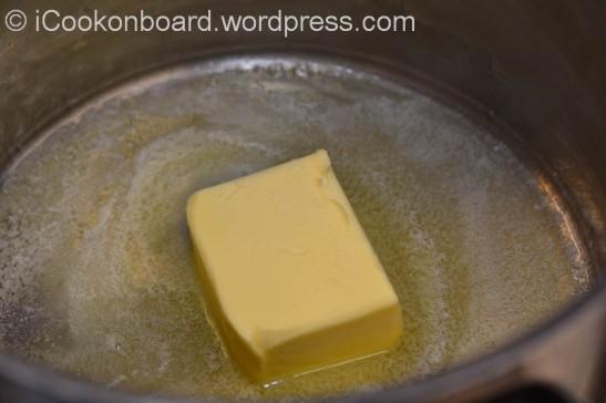 Melt butter on a soup pot.