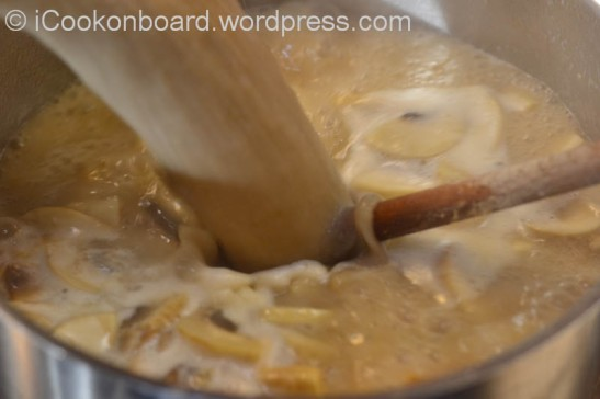 Add the mushroom puree and transfer pot to medium heat.