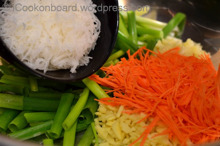 Add white radish and carrots into the mixing bowl.