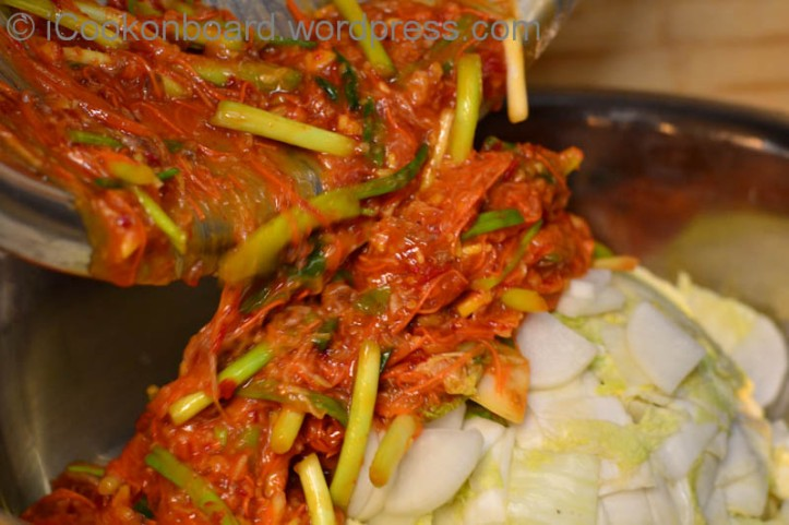 """Add the Kimchi sauce to the Napa """"Chinese"""" Cabbage."""