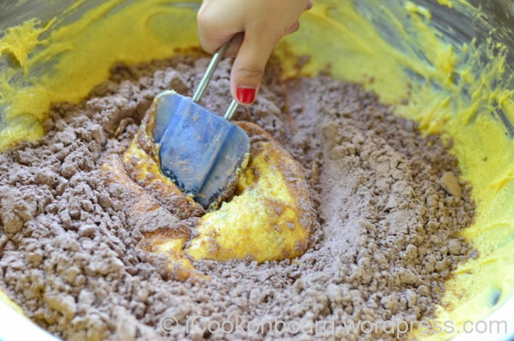Use a rubber scrapper to fold in the dry ingredients to the butter mixture.