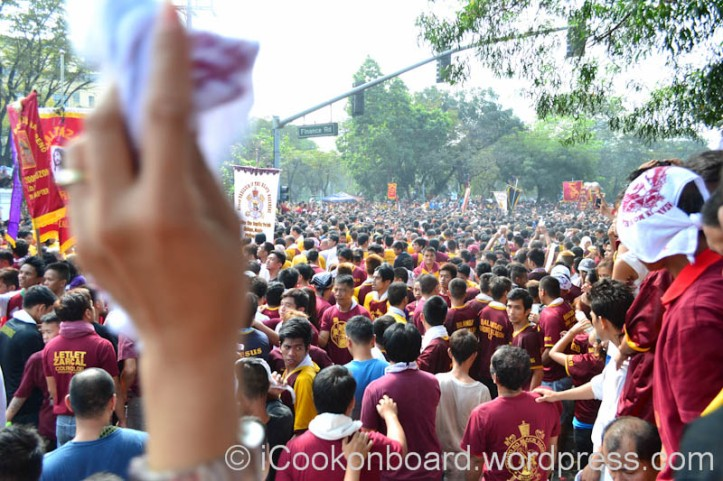 Foreground is my Wife's hand waving her towel to welcome the approaching Black Nazarene carriage. Pista ng Itim na Nazareno Photo by Nino Almendra