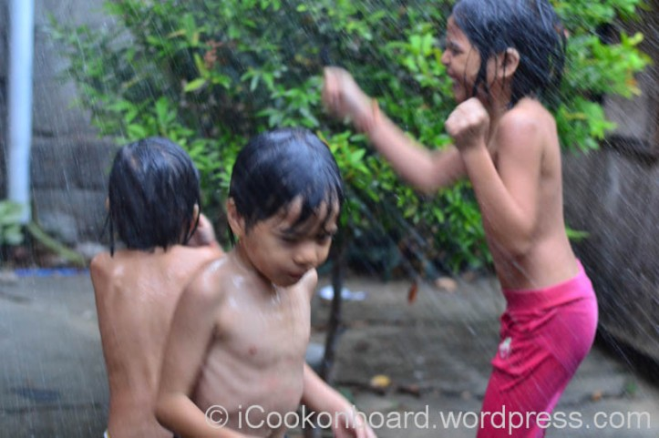 Jesica, Jerico and Shanea enjoying the rain of their own. Free Spa for Coffee Lovers Photo by Nino Almendra