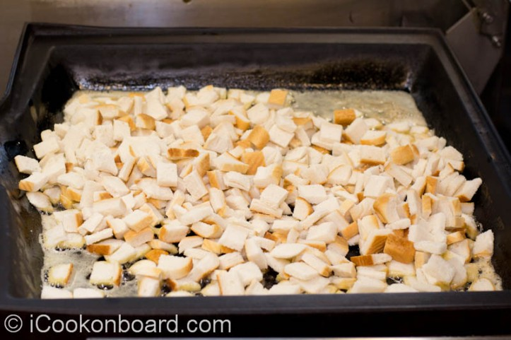 Spread the bread to the pan to evenly coat with butter.