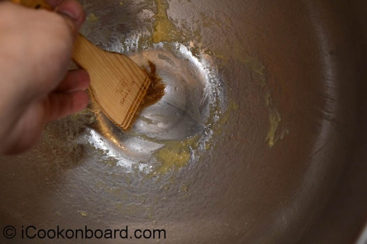 Either brush the bowl or rub the dough surface with vegetable oil and place it  back into the bowl.