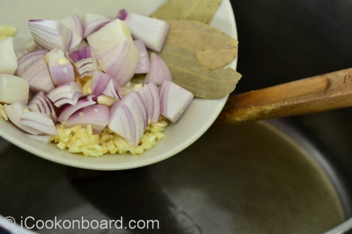 Saute garlic,onions and bayleaf until onions are translucent.