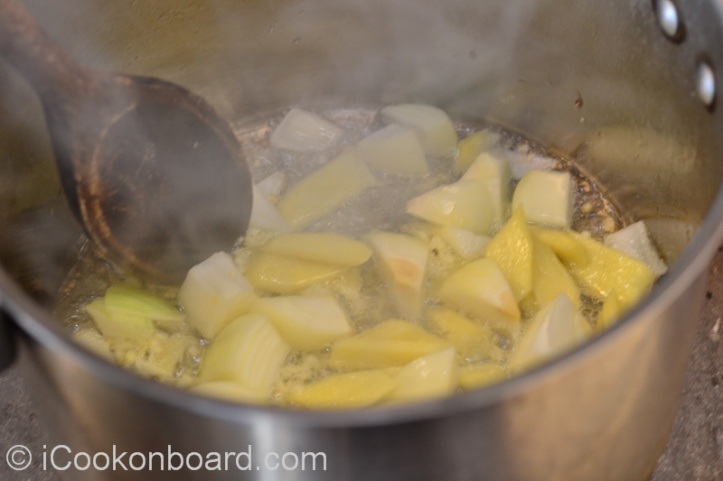 Stirring constantly until ginger and garlic is fragrant and onions become translucent.