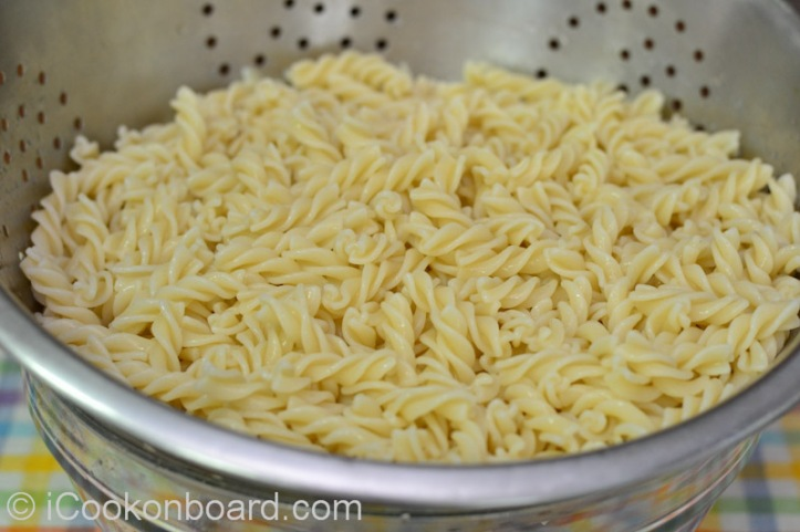 Drain pasta on a large colander and let it cool down or chill for several minutes.