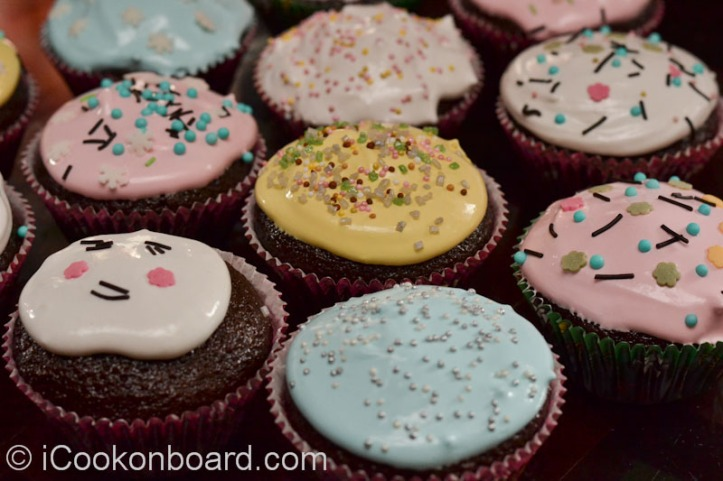 After baking, let the cup cakes cool completely. We use boiled icing for frosting. The best part is decorating it with your favorite sprinkle.