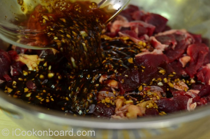 Place the sliced beef and marinade in a large mixing bowl.