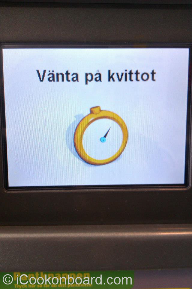 You need to press a button before the receipt will come out.  For non Swedish, you can ask assistance to know which button to press or how to use the machine.