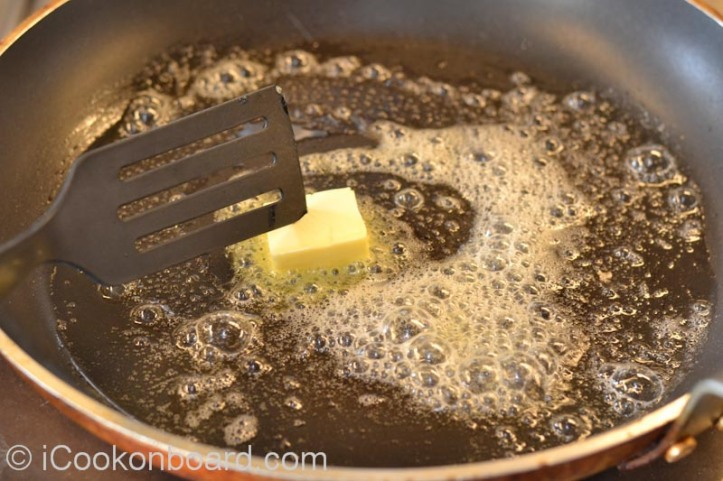 Heat cooking oil and butter on a large non-stick frying pan.
