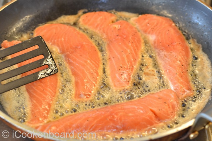 Pan-fry salmon fillet on very high heat in batches for 2 minutes on each side.