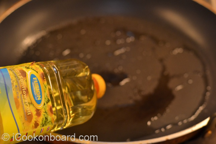 Heat cooking oil on a large non-stick fry pan.