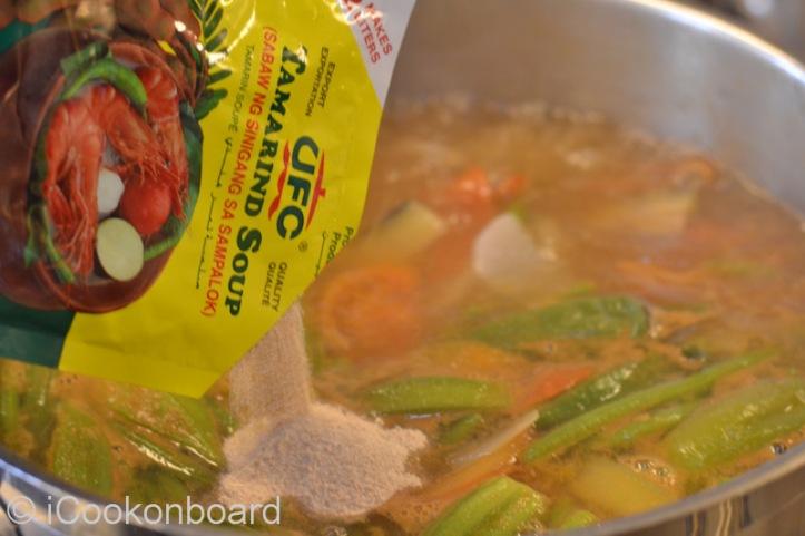 Add the tamarind soup powder/
