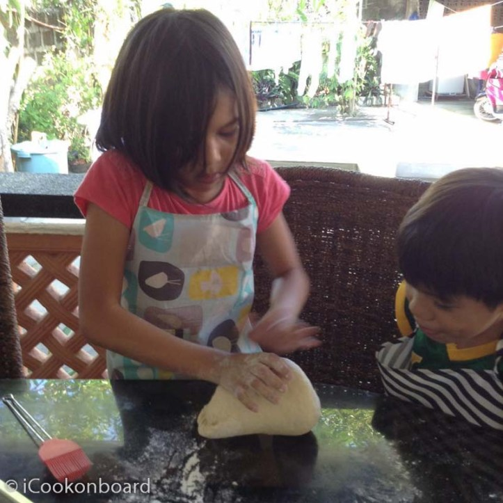 Teaching my kids how to knead a dough.