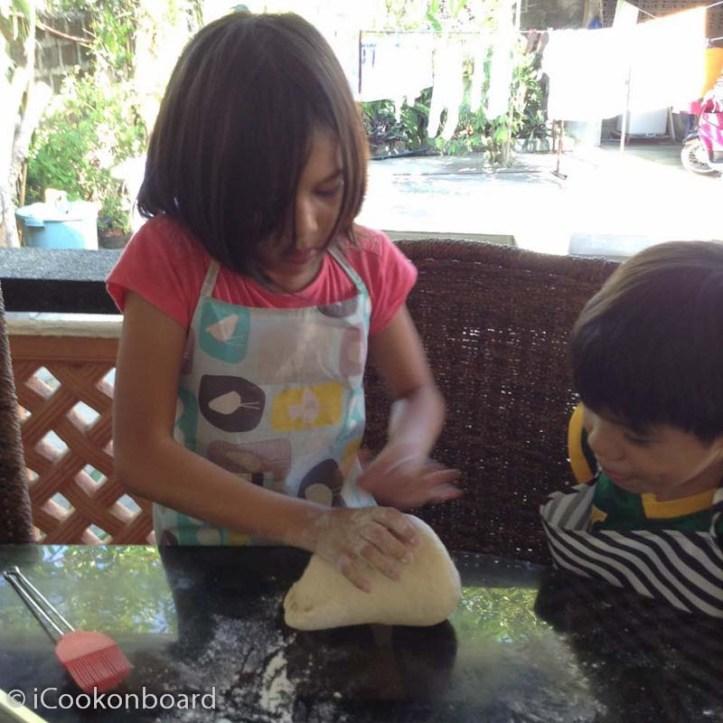Teaching my kids how to knead a dough.