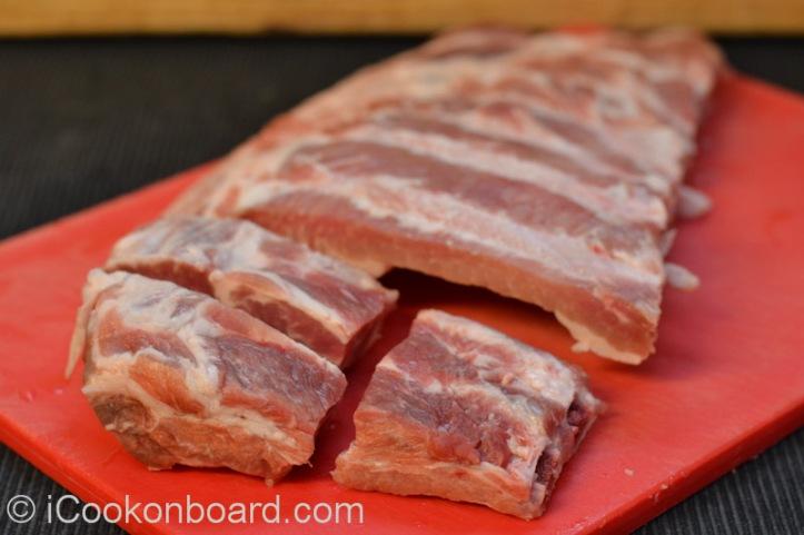 Cut pork ribs into chunks.
