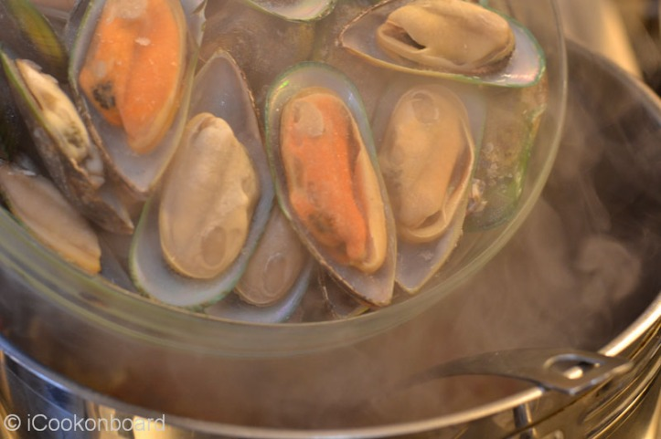 Add the green mussels.