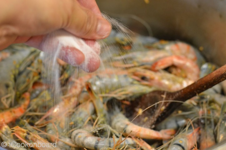Add a teaspoon of salt. It will allow the salt to sip into the prawns during the cooking process.